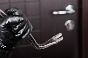 Burglar Breaking into Home - home security lighting