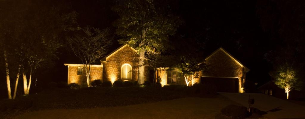 Up-lights on home and landscape.